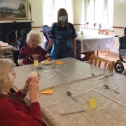 staff and residents eating